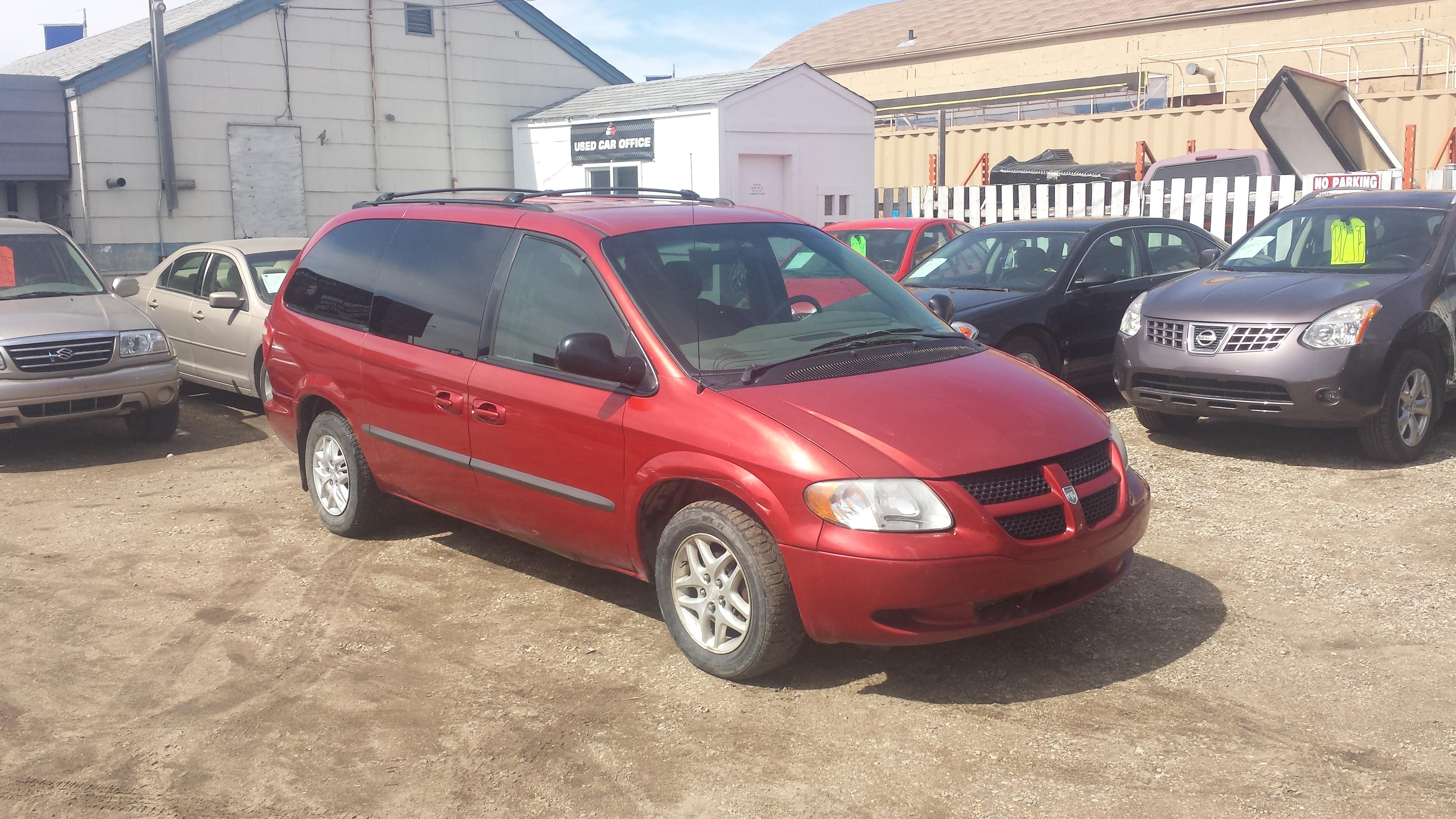 on Red 1997 Dodge Caravan